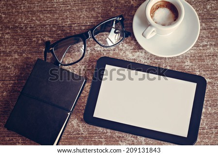 Coffee And Digital Tablet On Work Desk - stock photo