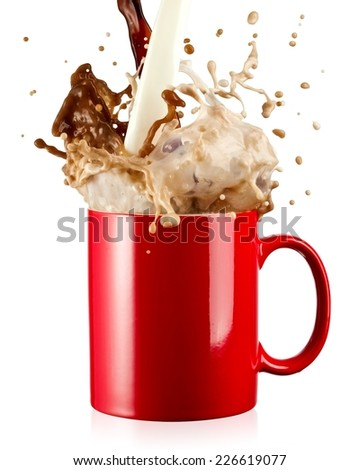 Coffee and milk pour and splash with drops from a red mug - stock photo