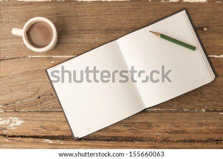 Coffee and note with pencil on the texture old wood. - stock photo