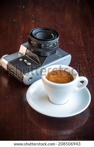 coffee and old retro camera - stock photo