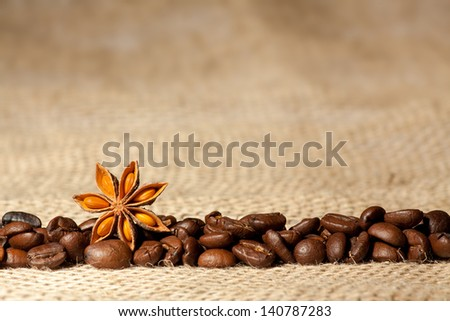 Coffee and Star Anise on sackcloth background with copyspace - stock photo