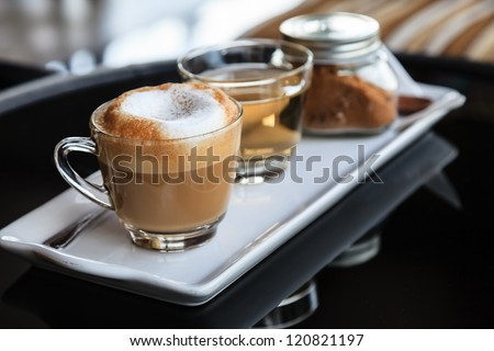 Coffee and tea on the white plate - stock photo