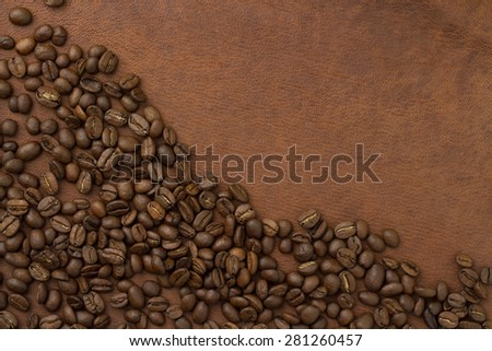 coffee beans an brown leather - stock photo