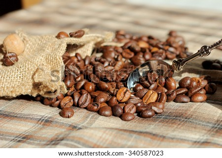 Coffee beans and a spoon - stock photo
