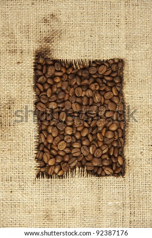 coffee beans and burlap - stock photo
