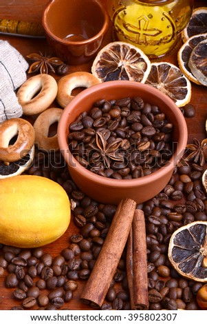 coffee beans and candle. lemon and cinnamon. anise and aroma spice - stock photo