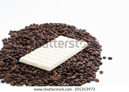 coffee beans and chocolate on a white background - stock photo