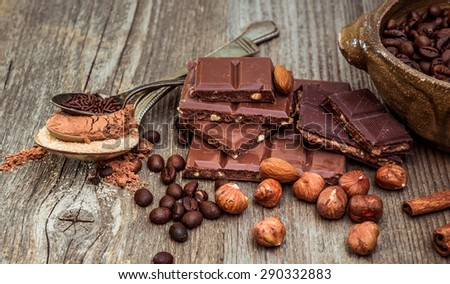 coffee beans and chocolate on a wooden background. - stock photo