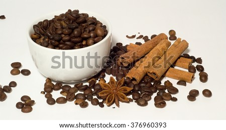 Coffee beans and cinnamon - stock photo