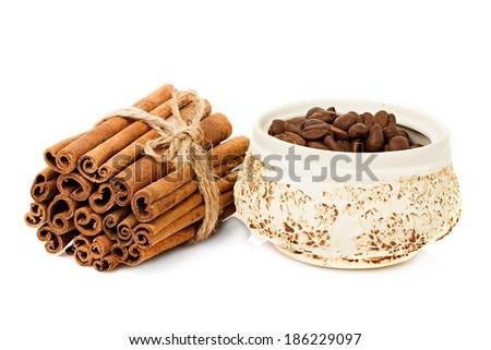 Coffee beans and cinnamon sticks - stock photo
