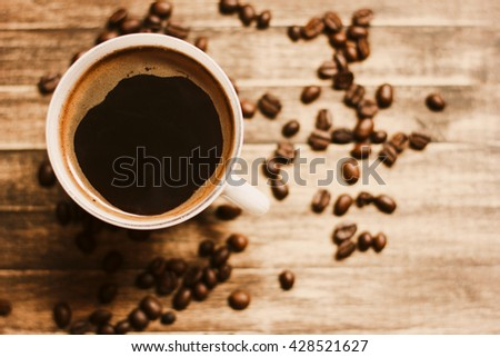 Coffee Beans And Coffee Cup Background./ Coffee Beans And Coffee Cup Background - stock photo