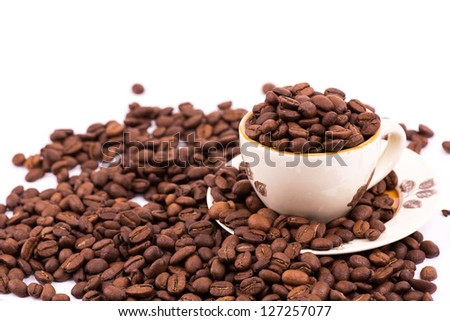 Coffee beans and cup of coffee background isolated on white - stock photo