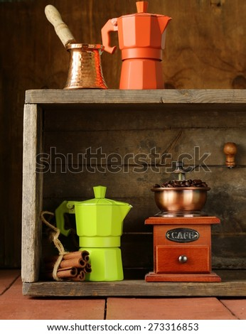 coffee beans and different utensils for boiling coffee (grinder, kettle, cezve) - stock photo