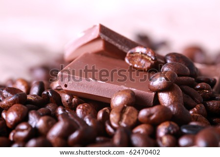 Coffee beans and milk chocolate - stock photo
