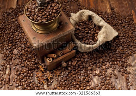 Coffee beans and old grinder  - stock photo