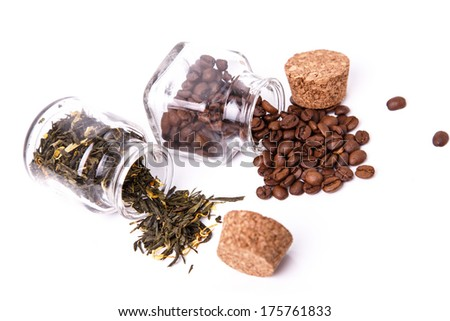 Coffee beans and tea in small jars - stock photo