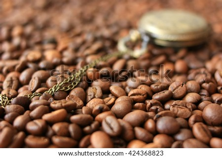Coffee beans and vintage watch - stock photo