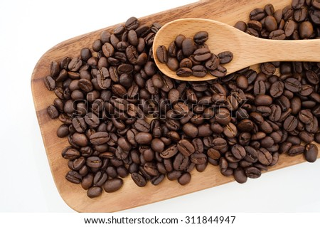 Coffee beans and wooden background on white. - stock photo