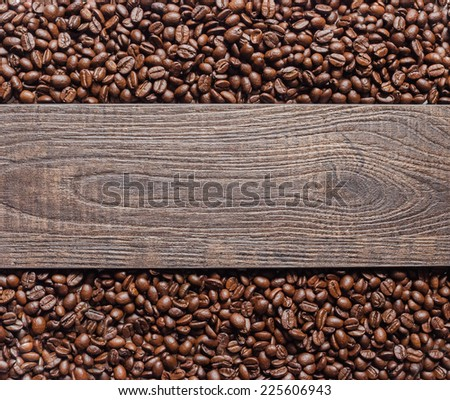 Coffee beans and wooden texture background. - stock photo