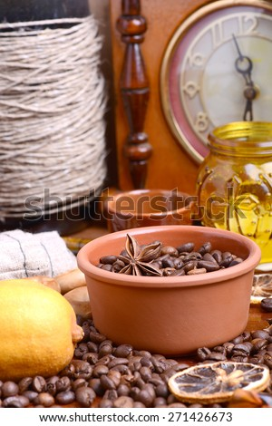 coffee beans, candle, old bottle, vintage clock, lemon, cinnamon, anise and aroma spice - stock photo