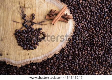 coffee beans,cinnamon,star anise,stump - stock photo