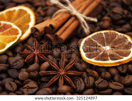 coffee beans, cinnamon sticks, star anise and dry oranges - stock photo