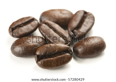 Coffee beans close up macro isolated on white bacground and studio shot. - stock photo