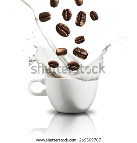 Coffee Beans Falling on Milk Splash - stock photo
