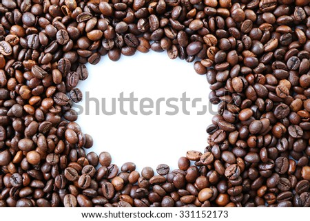 Coffee beans frame with white circle in centre - stock photo
