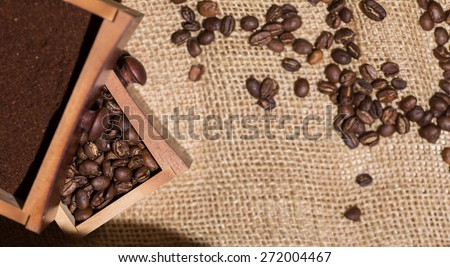 coffee beans, ground coffee, old wooden coffee  - stock photo