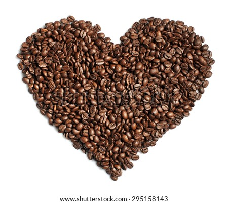 Coffee beans heart shaped on white - stock photo