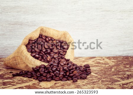 Coffee beans in a bag with filter effect retro vintage style - stock photo