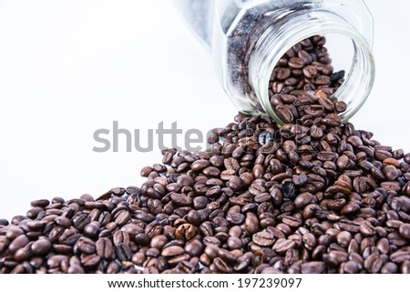 Coffee beans in a bottle - stock photo