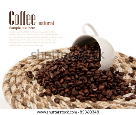 coffee beans in a cup isolated on a white background - stock photo