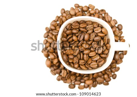 Coffee beans in a cup on white background - stock photo
