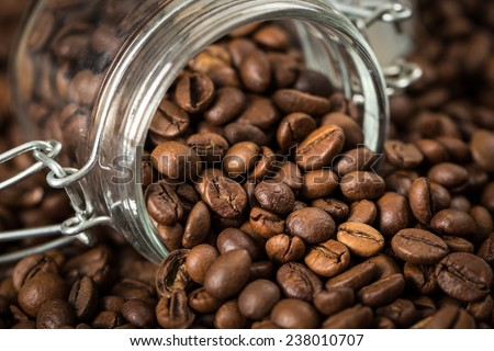 Coffee beans in a glass jar. - stock photo