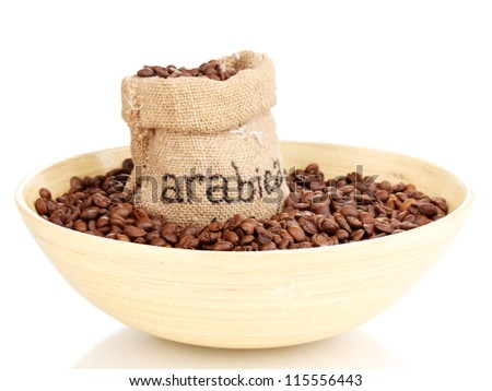 Coffee beans in bag and bowl isolated on white - stock photo