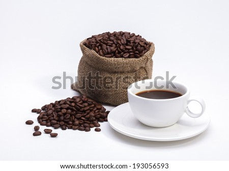 Coffee beans in bag and cup of coffee isolated on white background - stock photo