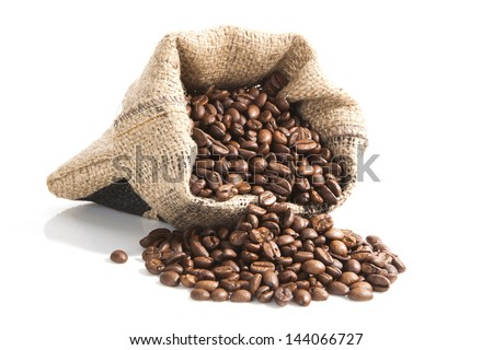 coffee beans in brown bag isolated on white background. culinary coffee still life. - stock photo