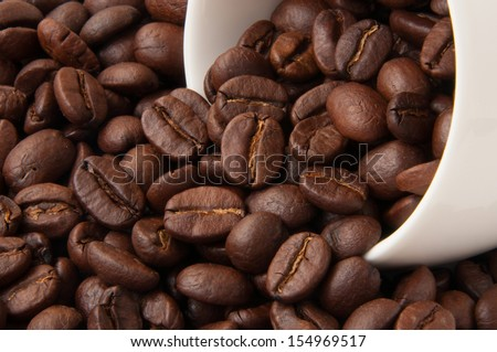 Coffee beans in cap - stock photo