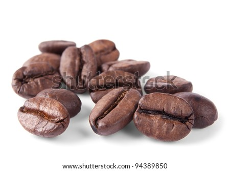 Coffee beans in closeup isolated on white background - stock photo