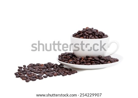 Coffee beans in coffee mug isolated on white background - stock photo