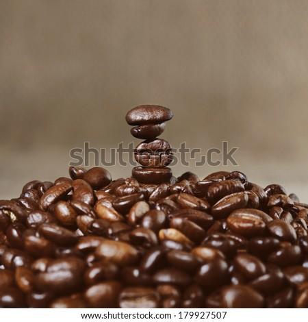 Coffee beans in perfect equilibrium - stock photo