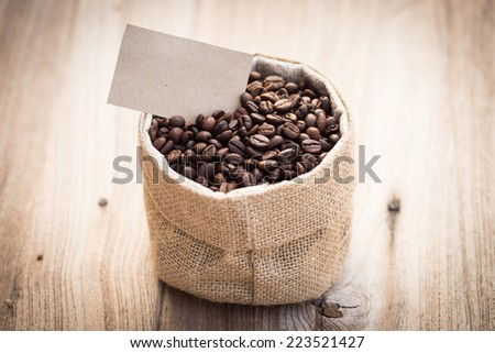 coffee beans in sack with label - stock photo