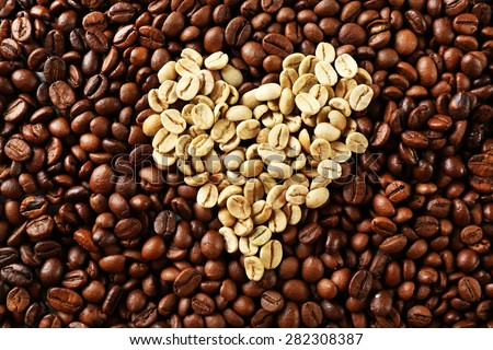Coffee beans in shape of heart, closeup - stock photo