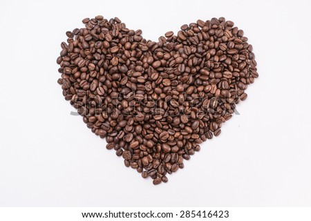 Coffee beans in shape of heart. coffee beans isolated on white background. roasted coffee beans, can be used as a background. - stock photo