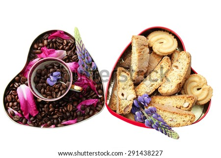 Coffee beans in the heart and tasty cookies also in the heart on white background - stock photo