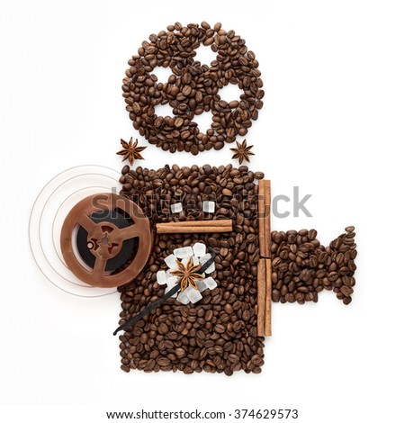 Coffee beans in the shape of an old movie projector for displaying cinema. - stock photo