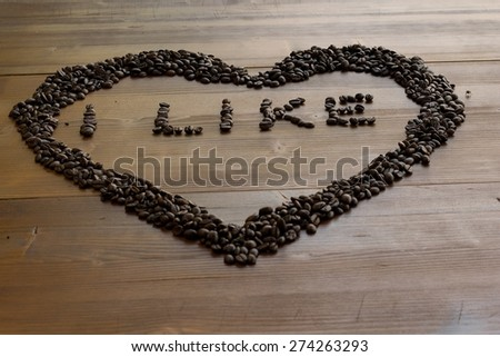 coffee beans inscription on the wooden table (Shallow DOF). - stock photo