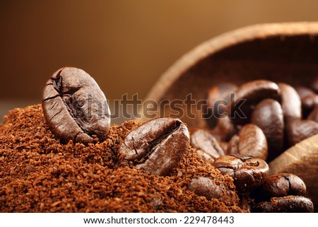 Coffee beans macro on a brown background - stock photo